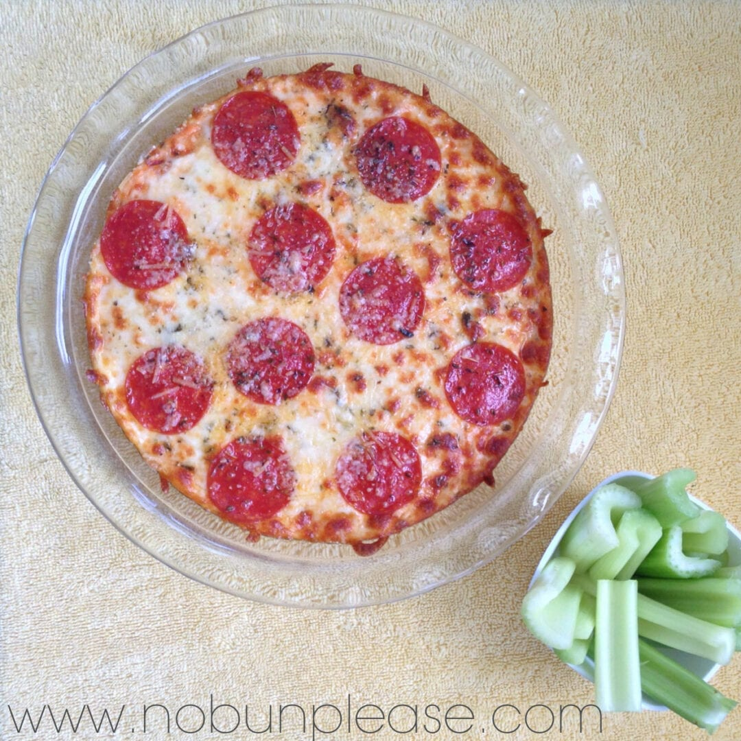 Creamy and zesty pizza dip that is topped with melted cheese and pepperoni. You won't miss the crust!