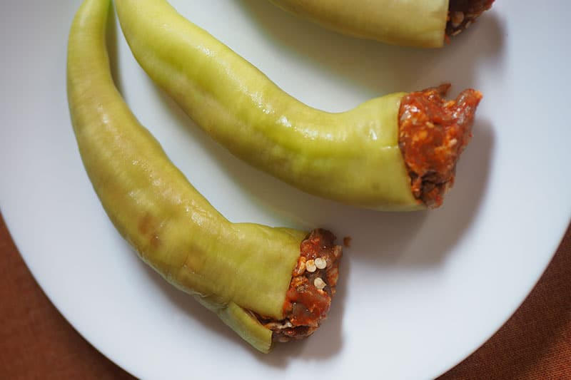 Banana pepper stuffed with raw sausage